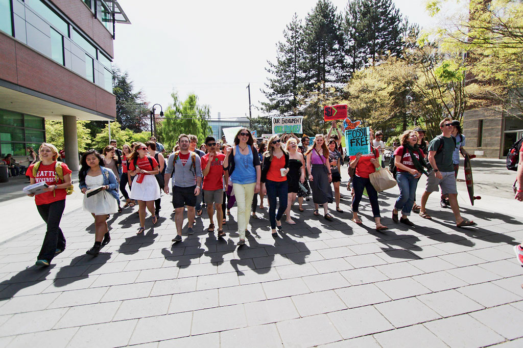 "Students at Seattle University march to the administration offices. For the divestment movement, Bill McKibben says, a fight is ""as good as a win."""
