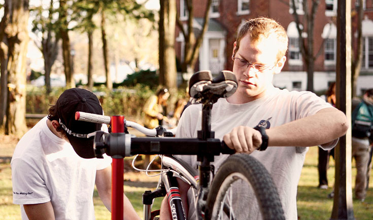 Students at Green Mountain College in Poultney, Vermont, repair bikes for campus commuters.