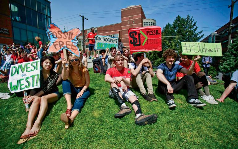 Students at Seattle University rally before delivering 600 petition signatures calling for divestment to the school's administration.