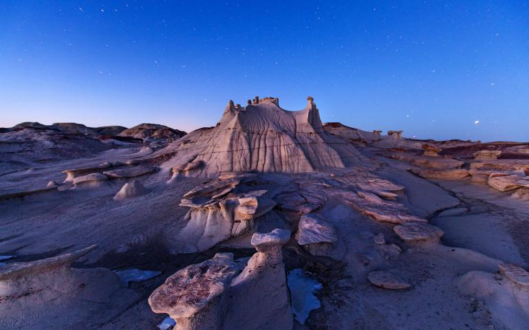 Wandering among the alien rock formations of New Mexico's Bisti/De-Na-Zin Wilderness Area, visitors often lose all sense of scale. This spire, known as a hoodoo, is barely six feet tall.