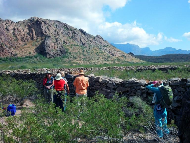 old stone corral with Chisos in distance