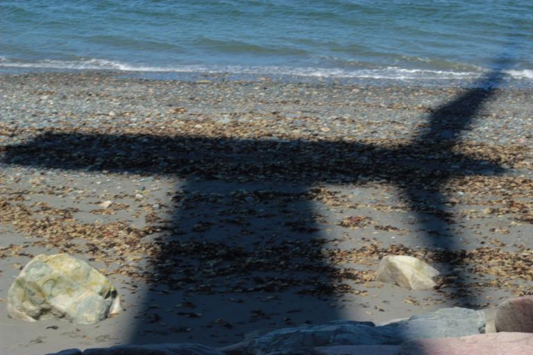 The shadow of the vanes of the Hull turbine on the beach