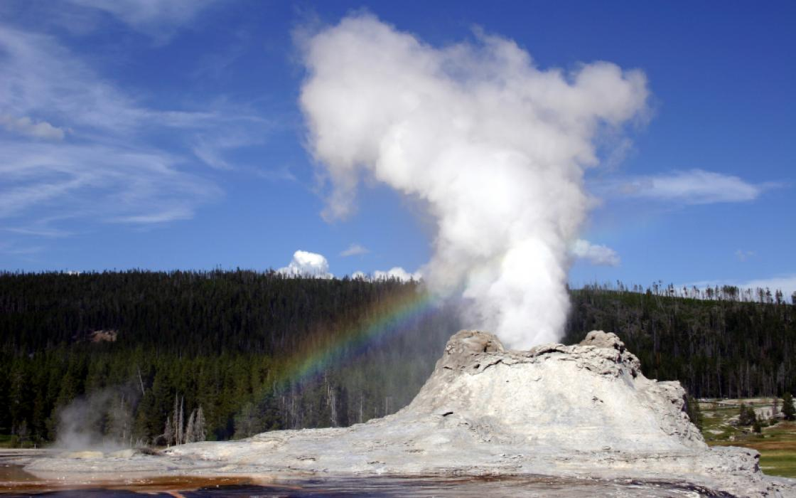 Geyser and rainbow at yellowstone