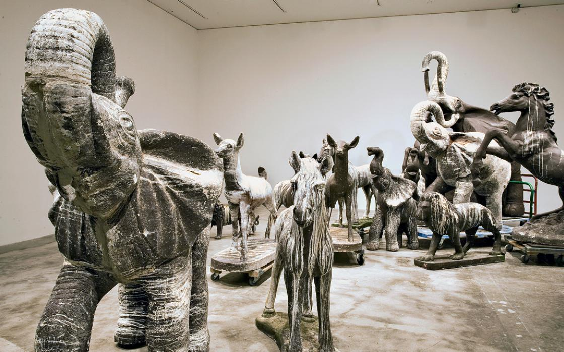 David Brooks, a professor at Maryland Institute College of Art, sculpted the animal figures in his Still Life With Stampede and Guano (2011) from concrete and a faux bronze surface, then left them out in a Florida Keys wildlife center for seabirds to dec