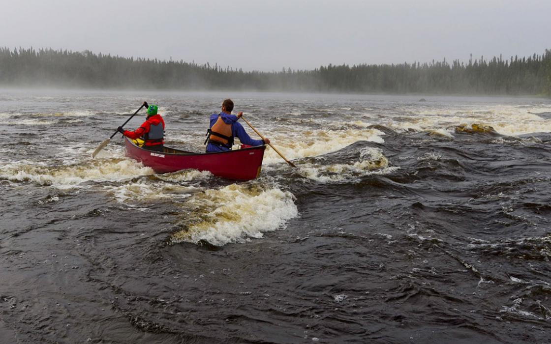 Pas de deux: Teamwork gets Conor and Kim Mihell down one of many rapids on northwestern Ontario's Otoskwin River.