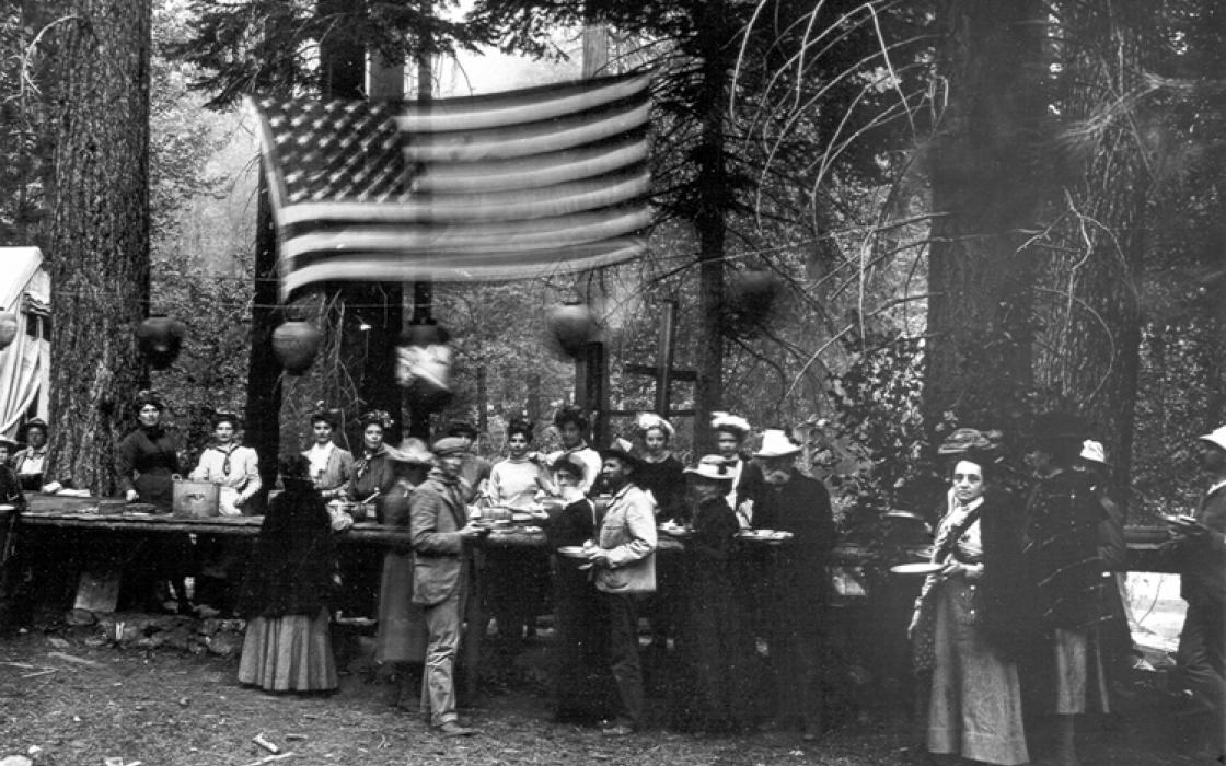 Serving dinner, 4th of July 1902 at Kings River. By Joseph N. LeConte.