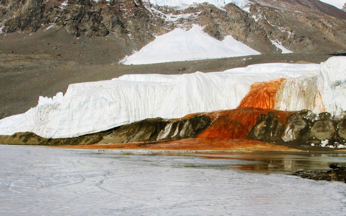 Blood Falls' grisly appearance comes from its iron-laden waters, which rust when they come in contact with the air, reddening the briny outflow as it trickles down Taylor Glacier onto ice-covered West Lake Bonney.