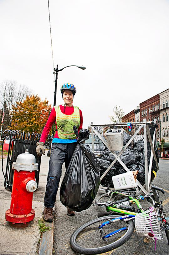 Rain, shine, or snow, Ruthy Woodring, cofounder of Pedal People, hauls away trash and recyclables for clients in Northampton, Massachusetts.