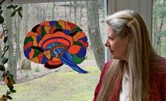 Dr. Jill Bolte Taylor with one of her stained glass brains.