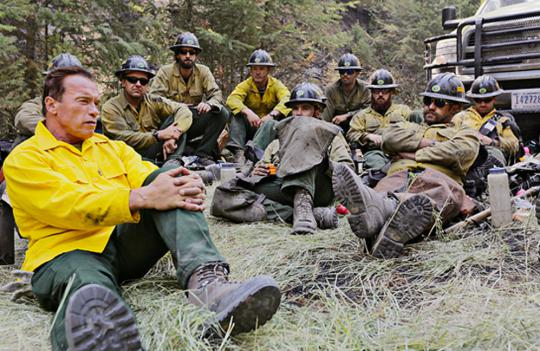 "Arnold Schwarzenegger hangs out with firefighting ""hotshots"" in Years of Living Dangerously, a new series by David Gelber (top left) and Joel Bach (below)."