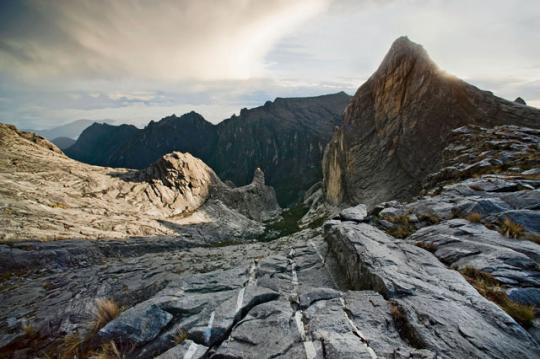 "Some believe Kinabalu derives from aki nabalu, meaning ""place of the dead"" in a language spoken by the Kadazan-Dusun people of Malaysian Borneo."