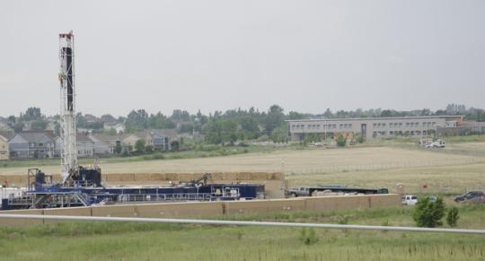 Colorado's fracking boom has led to natural gas wells everywhere, like this one next to the Red Hawk Elementary School in the Weld County town of Erie.
