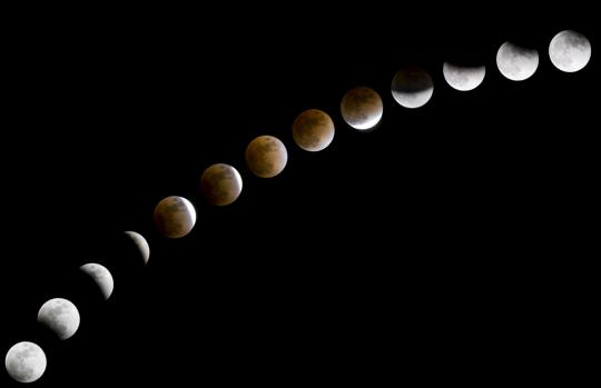 A series of images shows the progression of a lunar eclipse.