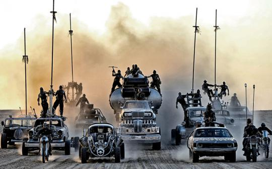 "In the environmentally degraded future portrayed in the film Mad Max: Fury Road, oil is precious, cars are worshipped as religious artifacts, and ""half-life war boys"" drive around the desert in synchronized style."