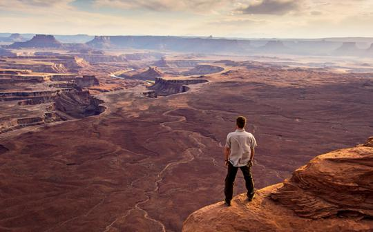 A man enjoys the view near Green River Overlook in Canyonlands National Park, Utah.