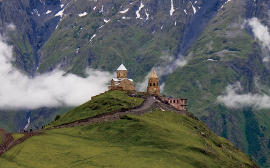 The Gergeti Trinity Church sits below 16,500-foMt. Kazbek in the Caucasus Mountains of Kazbegi, Georgia.