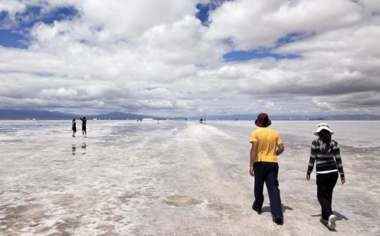Vast sky meets the cracked, crusty expanse of Argentina's Salinas Grandes.