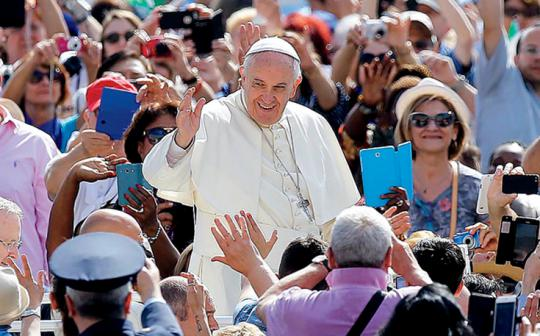 Pope Francis greets the crowd as he arrives in St. Peter's Square, Vatican City.