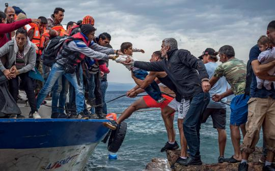 Migrants arrive at the Greek island of Lesbos after crossing the Aegean Sea from Turkey.
