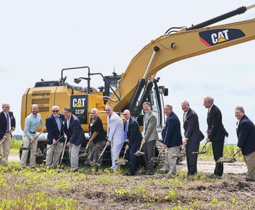 Iberdrola Renewables and Amazon Web Services break ground in an empty field in rural North Carolina.