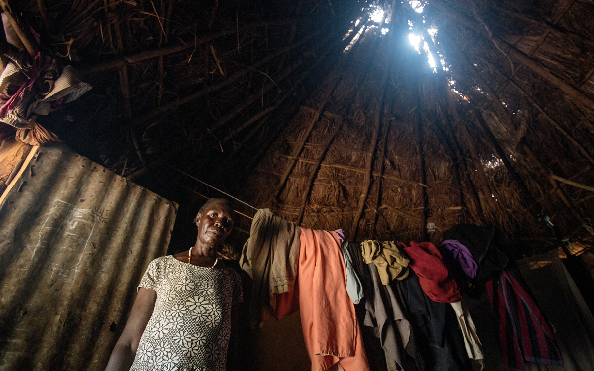 """Holes in the roof of village huts are commonplace. The grass used to repair them is a casualty of changing weather."