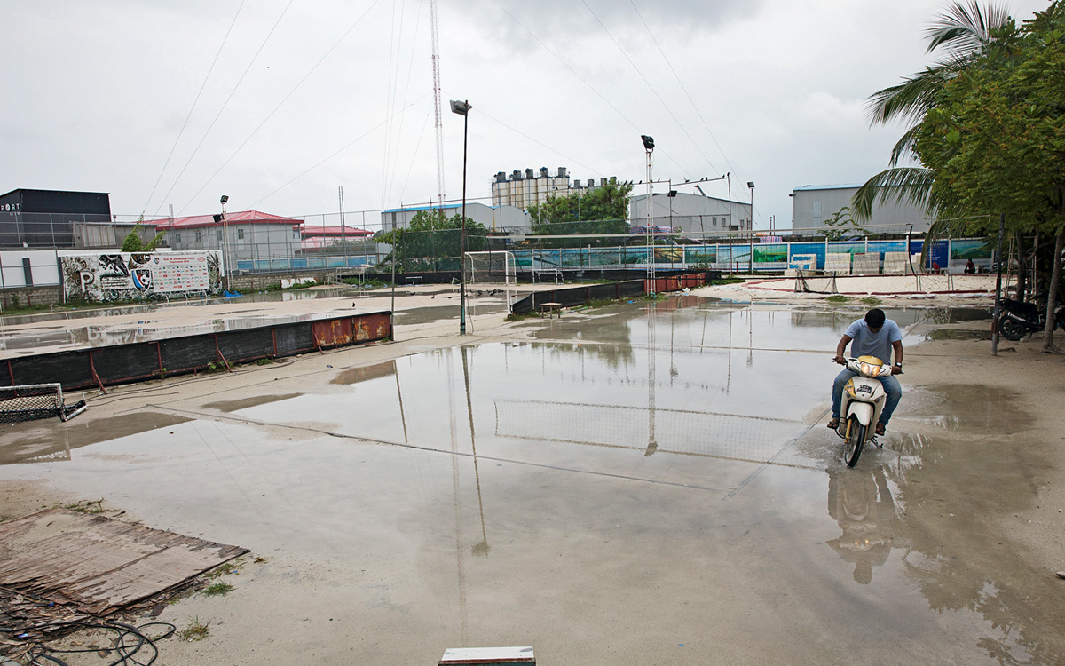 A shortcut across a flooded soccer field in Malé, the densely populated capital of the Maldives;