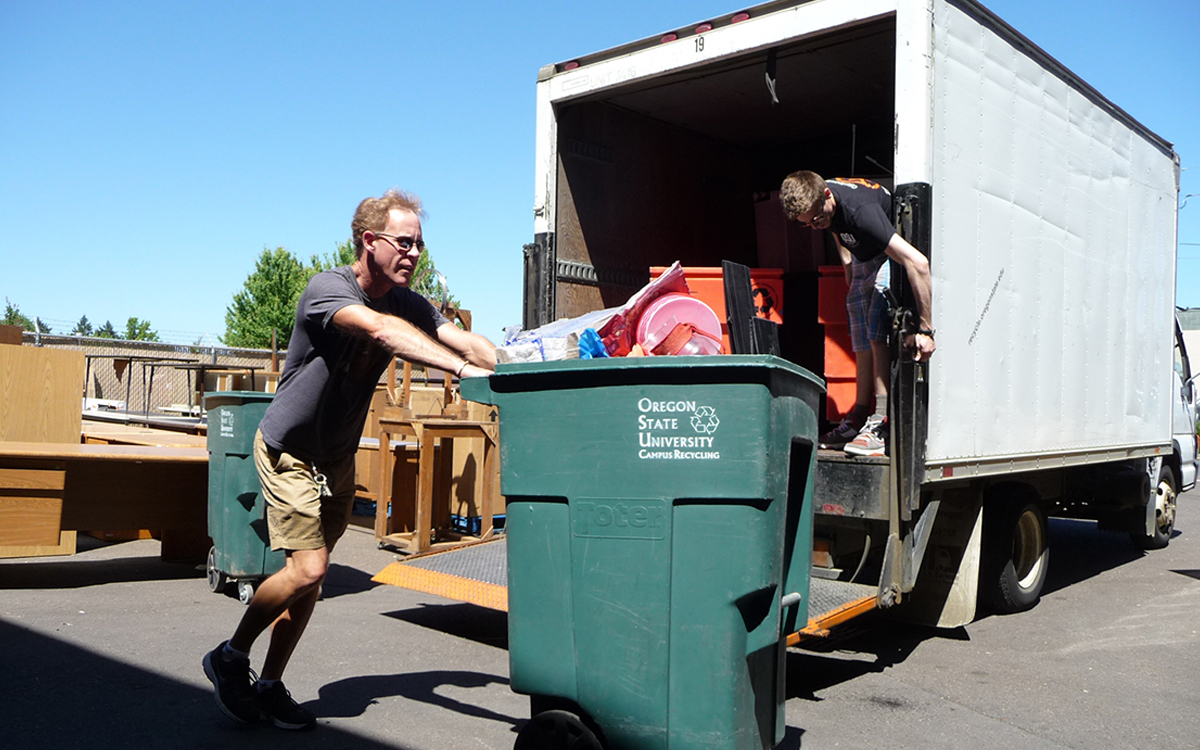 OSU staff move materials during the Move Out Donation Drive, which in 2018 collected over 32,300 pounds of reusable material.