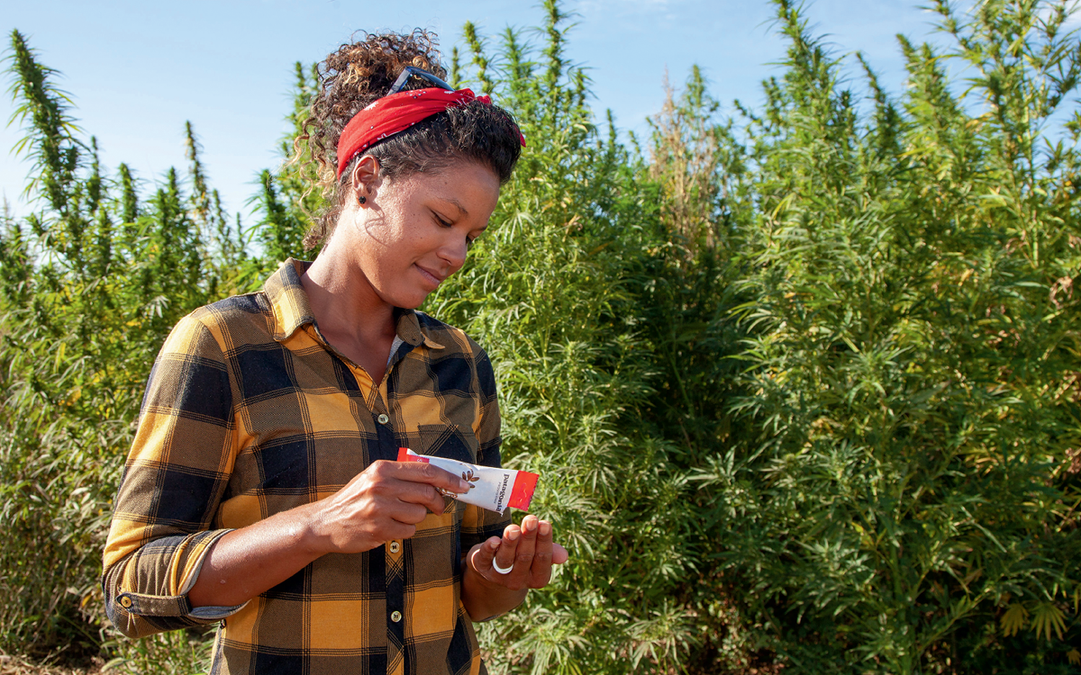 Hemp farmer Shani Coleman pours a pack of Patagonia Provisions Organic Savory Seeds into her hand.