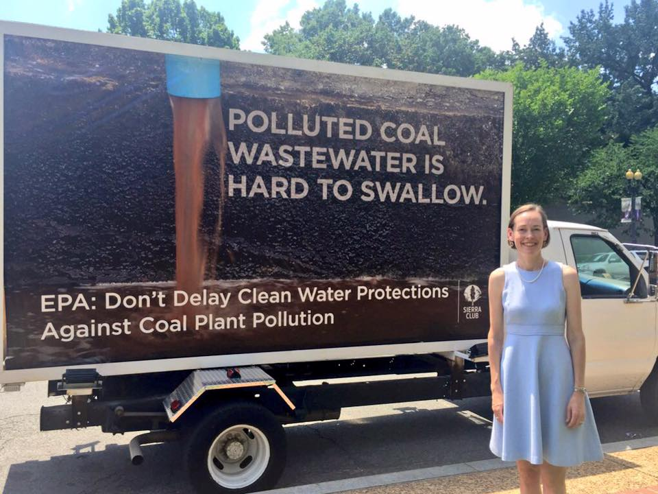 Mary Anne Hitt stands by the mobile billboard at the EPA hearing.