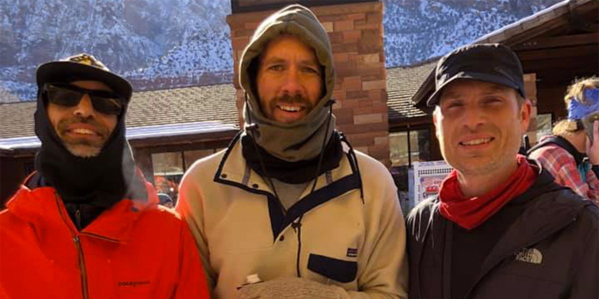 James, Ryan, and Adam, all from Los Angeles, bundled up to keep warm after their quick finish.